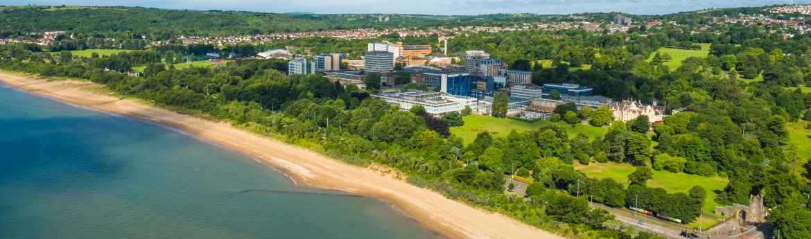 Aerial view of Swansea University from the bay.