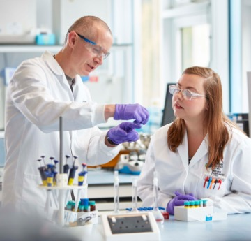 2 people at a laboratory table