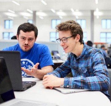 2 Students sat at computer