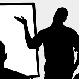 silhouette of a man making a presentation