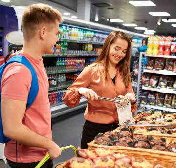 Two students shopping in Costcutter retail outlet on Singleton Campus