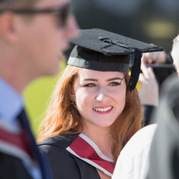 Girl at graduation smiling