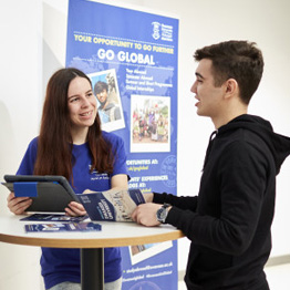 Two people talking at a Go Global stand