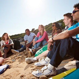 Group of students sitting on a beach